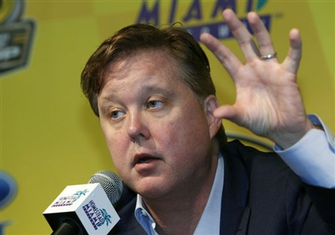 NASCAR chairman Brian France gestures as he speaks during a news conference, Friday, Nov. 19, 2010, at Homestead-Miami Speedway in Homestead, Fla. France is still considering changes to its title format even though it's at the end of the closest championship race in seven years.  (AP Photo/Wilfredo Lee)