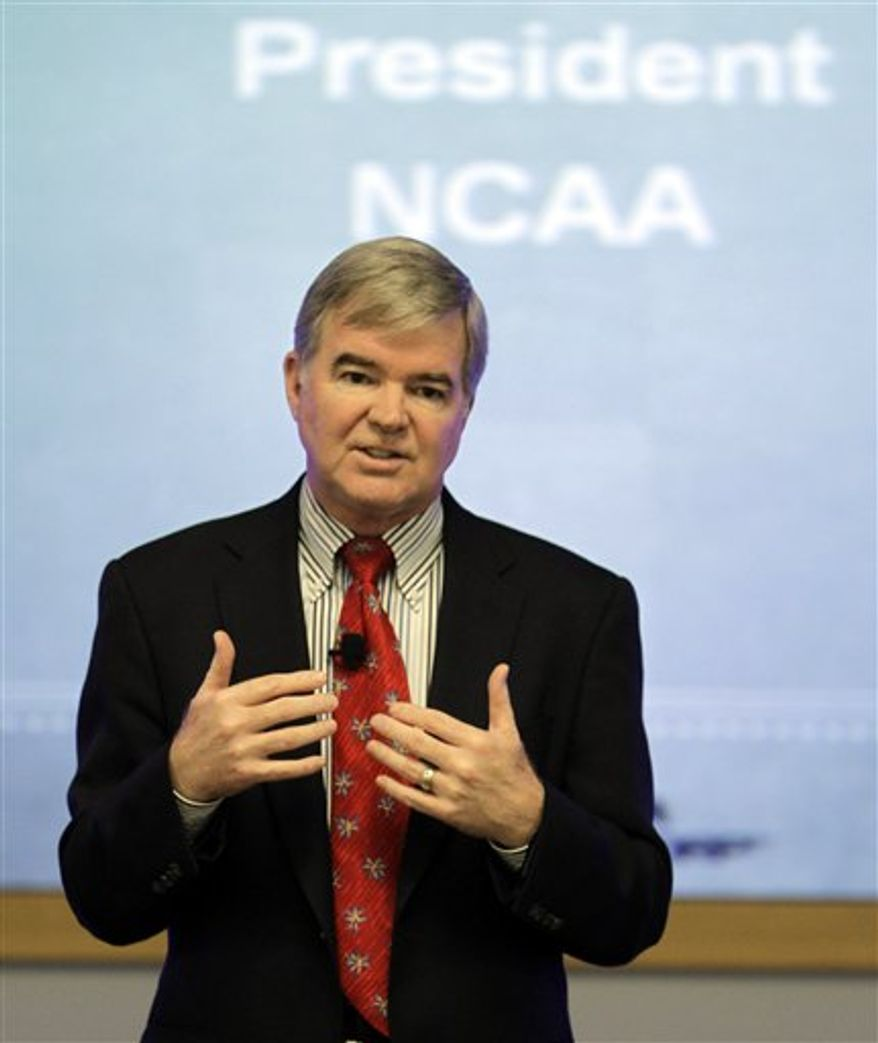 "FILE - This Oct. 7, 2010, file photo shows NCAA President Mark Emmert speaking during the Indiana Sports Corporation annual meeting in Indianapolis. Emmert says he wants investigations such as that of Auburn quarterback Cam Newton to be ""as efficient and expedited"" as possible but ""you've got to get the facts right."" At Friday's, Nov. 19, 2010,  taping of a TV show to air Monday on the Big Ten Network, Emmert said the NCAA's ""burden of proof is higher than what it is for somebody who's writing in a blog."" (AP Photo/Darron Cummings, File)"