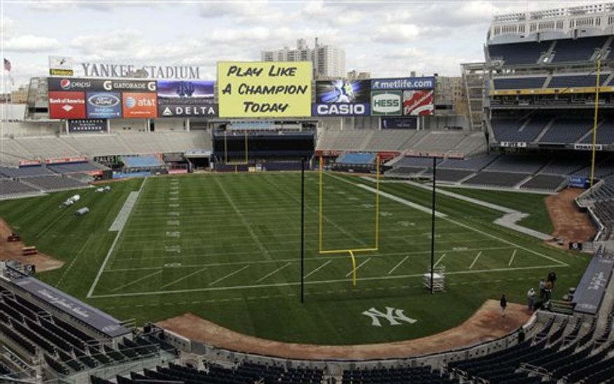 Uprights are installed next to the New York Yankees logo on the field at Yankee Stadium which has been converted for Saturday's scheduled NCAA college football game between Notre Dame and Army, Wednesday, Nov. 17, 2010, in New York. (AP Photo/Kathy Willens)