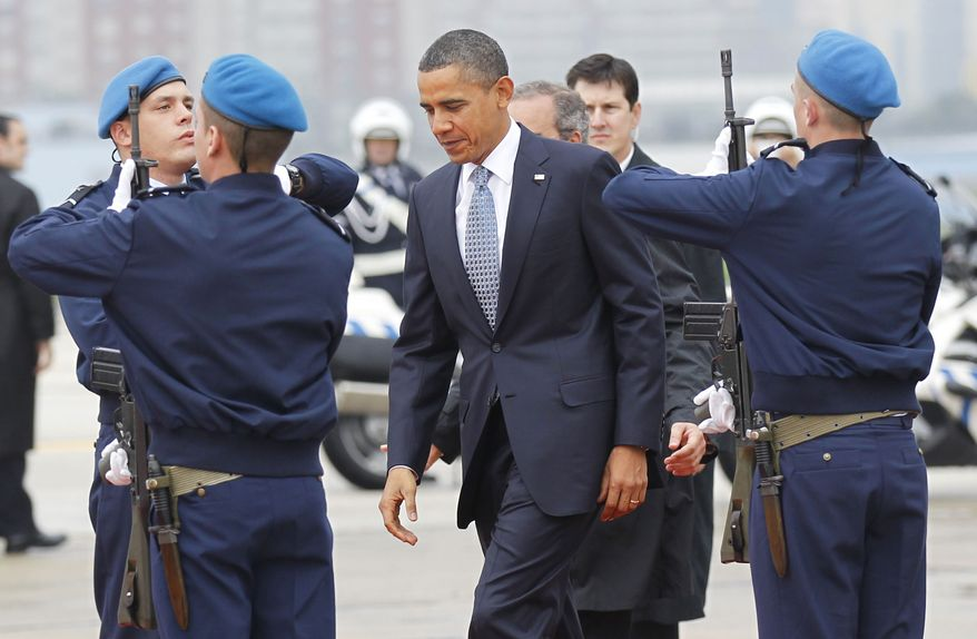 President Obama during his arrival in Lisbon, Portugal, Friday, Nov. 19, 2010, for summits with NATO partners and the European Union. (AP Photo/Pablo Martinez Monsivais)