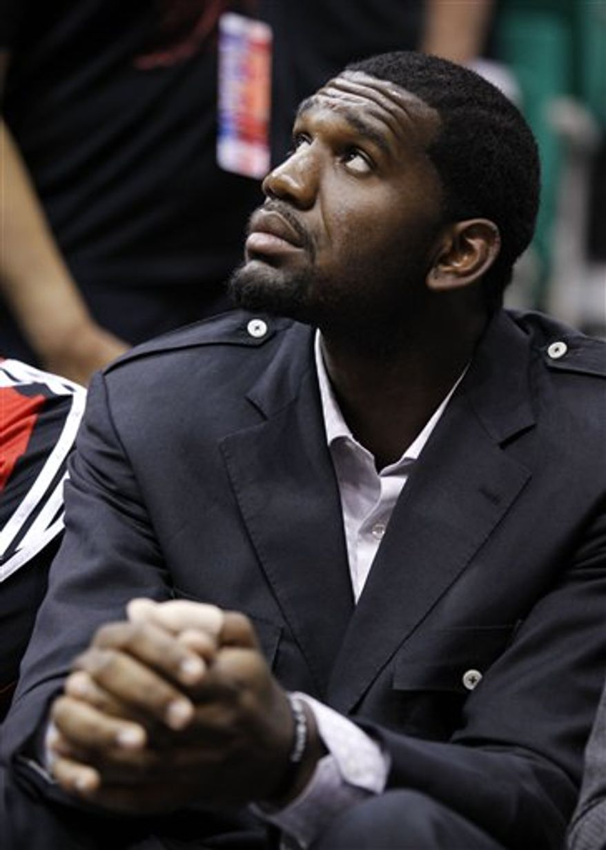 "FILE - In this Oct. 7, 2010, file photo, Portland Trail Blazers Greg Oden sits on the bench during the first half of their NBA preseason basketball game against the Utah Jazz in Salt Lake City. With Oden neeeding another knee operation and missing another season, Portland coach Nate McMillan confronts the ""Curse of the Trail Blazers' Big Men."" (AP Photo/Colin E Braley, File)"