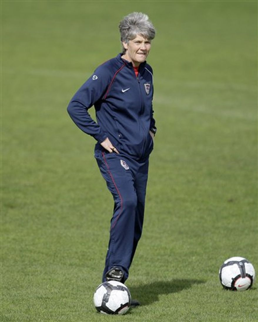 FILE - This is a Feb. 28, 2010, file photo shows the United States women's soccer team coach Pia Sundhage duirng a training session in Guia, southern Portugal. Thanks to a stunning upset in CONCACAF qualifying, it's the top-ranked and two-time world champion United States that Italy gets in the two-leg playoff, which begins Saturday in Padova, Italy. (AP Photo/Armando Franca, Filoe)