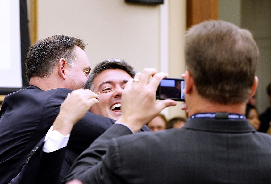 Rep.-elect Cory Gardner, R-Colo., reacts on Capitol Hill in Washington, Friday, Nov. 19, 2010,  as he drew number one as the incoming House of Representatives members drew in a lottery to pick their office space. (AP Photo/Harry Hamburg)