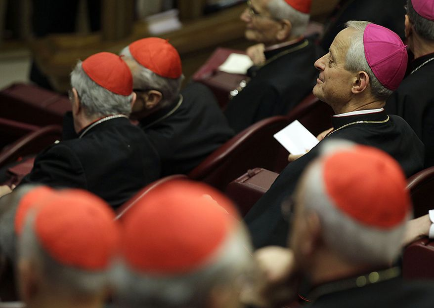 """Archbishop of Washington Cardinal-designate Donald W. Wuerl, top left, listens as Pope Benedict XVI delivers his message to cardinals he summoned for a day of reflection at the Vatican, Friday, Nov. 19, 2010, the day before a ceremony to create 24 new cardinals. The top agenda, religious freedom, grew remarkably timely given China's planned ordination Saturday of a bishop who doesn't have the Pope's approval. The Vatican warned China that efforts at reconciliation would be set back if bishops loyal to the pope were forced to attend the ordination. The Vatican said such actions would constitute """"grave violations of freedom of religion and freedom of conscience.'' (AP Photo/Alessandra Tarantino)"""