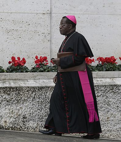 """Archbishop of Kinshasa, Democratic Republic of Congo, Laurent Monsengwo Pasinya arrives to attend a meeting of cardinals summoned by Pope Benedict XVI for a day of reflection at the Vatican, Friday, Nov. 19, 2010, the day before a ceremony to create 24 new cardinals. The top agenda, religious freedom, grew remarkably timely given China's planned ordination Saturday of a bishop who doesn't have the Pope's approval. The Vatican warned China that efforts at reconciliation would be set back if bishops loyal to the pope were forced to attend the ordination. The Vatican said such actions would constitute """"grave violations of freedom of religion and freedom of conscience.'' Pasinya is one of the 24 prelates that will be elevated to cardinal on Saturday. (AP Photo/Alessandra Tarantino)"""