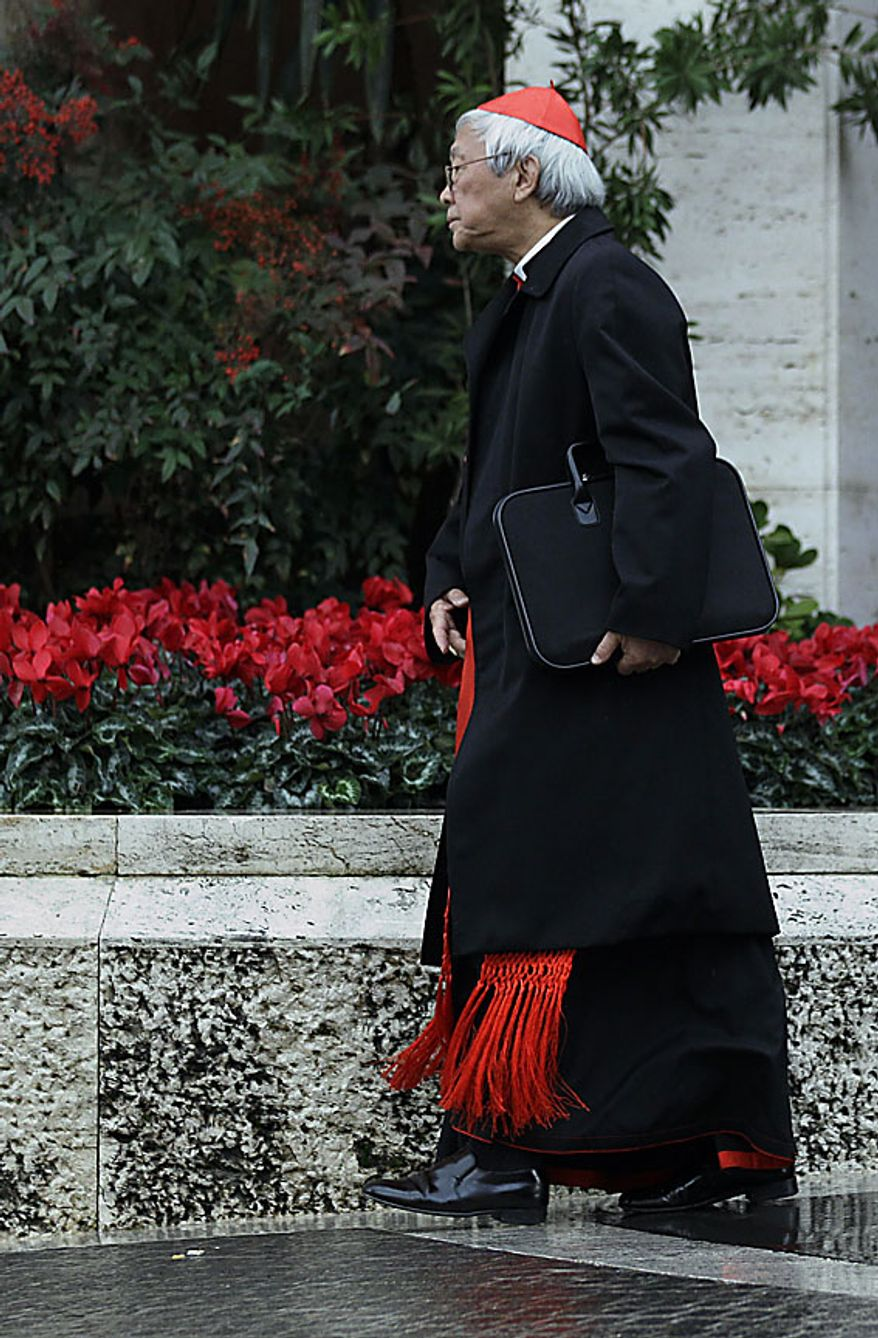 """Hong Kong Cardinal Joseph Zen leaves a meeting of cardinals with Pope Benedict XVI for a day of reflection at the Vatican, Friday, Nov. 19, 2010, the day before a ceremony to create 24 new cardinals. The top agenda, religious freedom, grew remarkably timely given China's planned ordination Saturday of a bishop who doesn't have the Pope's approval. The Vatican warned China that efforts at reconciliation would be set back if bishops loyal to the pope were forced to attend the ordination. The Vatican said such actions would constitute """"grave violations of freedom of religion and freedom of conscience.''  (AP Photo/Alessandra Tarantino)"""