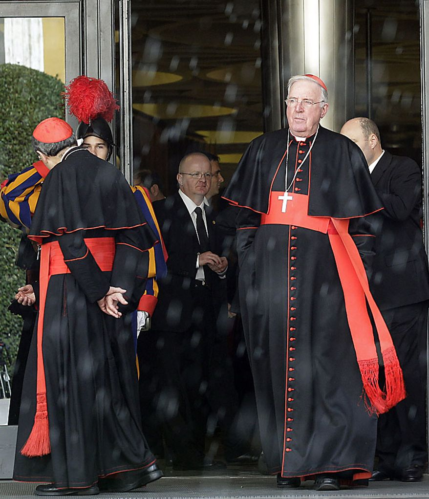 "Westminster archbishop emeritus Cormac Murphy O'Connor, right, pauses in the doorway in rain as he arrives for a meeting of cardinals summoned by Pope Benedict XVI for a day of reflection at the Vatican, Friday, Nov. 19, 2010, the day before a ceremony to create 24 new cardinals. The top agenda, religious freedom, grew remarkably timely given China's planned ordination Saturday of a bishop who doesn't have the Pope's approval. The Vatican warned China that efforts at reconciliation would be set back if bishops loyal to the pope were forced to attend the ordination. The Vatican said such actions would constitute ""grave violations of freedom of religion and freedom of conscience.'' (AP Photo/Alessandra Tarantino)"