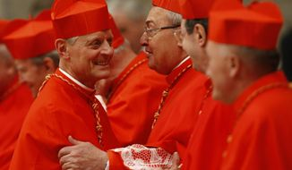 Newly appointed U.S. Cardinal Donald W. Wuerl, left, is congratulated by other cardinals after being elevated by Pope Benedict XVI during a consistory inside St. Peter's Basilica, at the Vatican on Saturday, Nov. 20, 2010. Benedict XVI formally created 24 new cardinals on Saturday amid cheers in St. Peter's Basilica, bringing a mostly Italian group into the elite club that will eventually elect his successor. (AP Photo/Pier Paolo Cito)