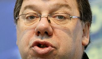 Irish Prime Minister Brian Cowen speaks to the media Friday at the opening of the terminal 2 building at Dublin City Airport. The euro is continuing to rise modestly against the dollar amid hopes of a resolution to Ireland's debt crisis. Ireland appears headed toward taking a loan from the European Union to bolster its debt-crippled banks, helping take the edge off recent fears about the resurgence of Europe's debt troubles. (Associated Press)