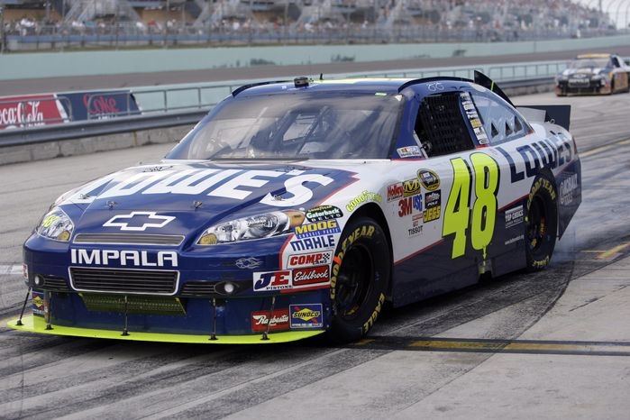 ASSOCIATED PRESS NASCAR driver Jimmie Johnson leaves the pits during the Ford 400 auto race Sunday Nov. 21, 2010 in Homestead, Fla.