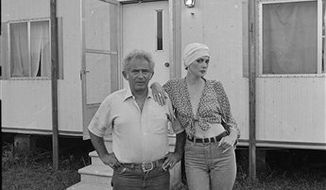 ** FILE ** In this Feb. 7, 1981 file photo, author Norman Mailer, left, and Norris Church arrive at the New York's Radio City Music Hall. Norris Church Mailer, an actress, model, author and painter who enjoyed and endured the ride of her life as the sixth and final wife of Norman Mailer, died at her home in Brooklyn on Sunday, Nov. 21, 2010. She was 61. (AP File Photo)