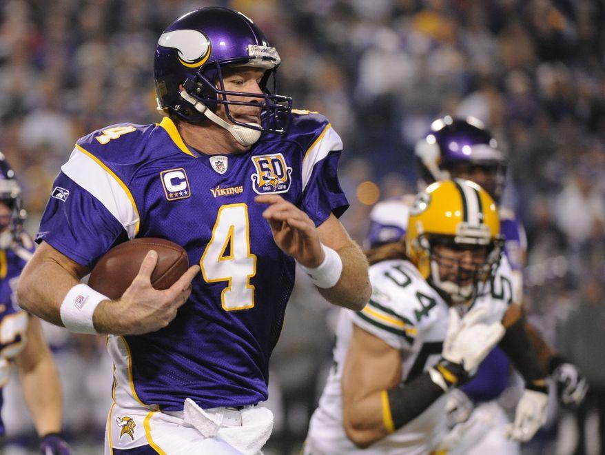 ASSOCIATED PRESS Minnesota Vikings quarterback Brett Favre (4) carries the ball while under pressure from Green Bay Packers linebacker Brandon Chillar (54) during the first quarter of an NFL football game Sunday, Nov. 21, 2010, in Minneapolis.