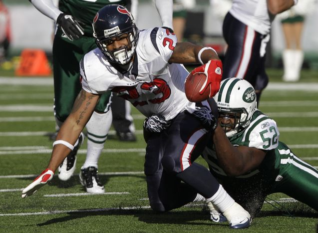 ASSOCIATED PRESS Houston Texans running back Arian Foster (23) is tackled by New York Jets linebacker David Harris (52) during the first quarter of an NFL football game between the Houston Texans and the New York Jets at New Meadowlands Stadium Sunday, Nov. 21, 2010, in East Rutherford, N.J.