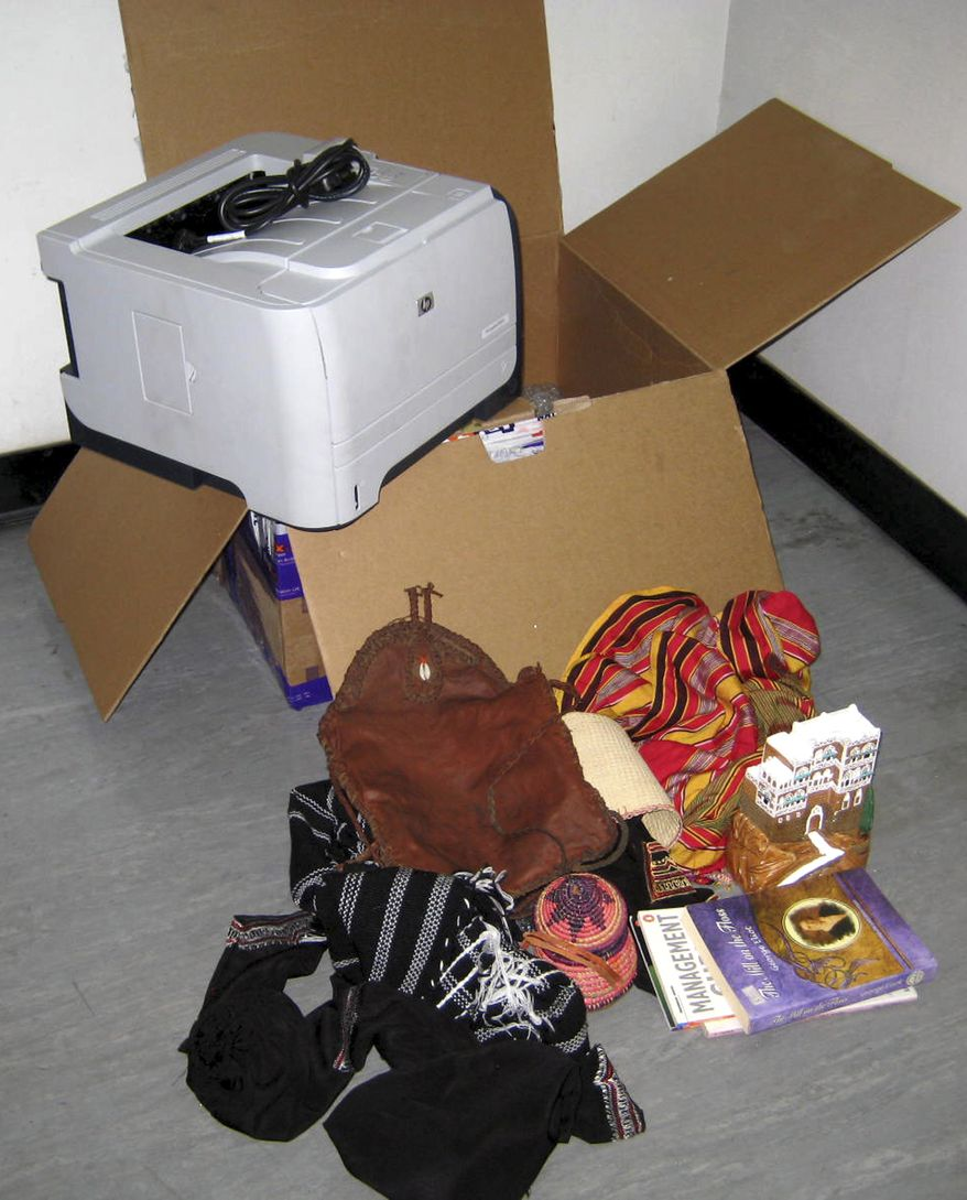 **FILE** This undated photo released on Oct. 30, 2010 by the Dubai Police via the state Emirates News Agency (WAM) claims to show a computer printer and other contents of a package found onboard a cargo plane coming from Yemen, in Dubai, United Arab Emirates. Terrorist monitoring groups say al Qaeda of the Arabian Peninsula claims its attempts to blow up package bombs on two cargo flights headed to the U.S. cost only $4,200. (Associated Press/Dubai Police via Emirates News Agency)