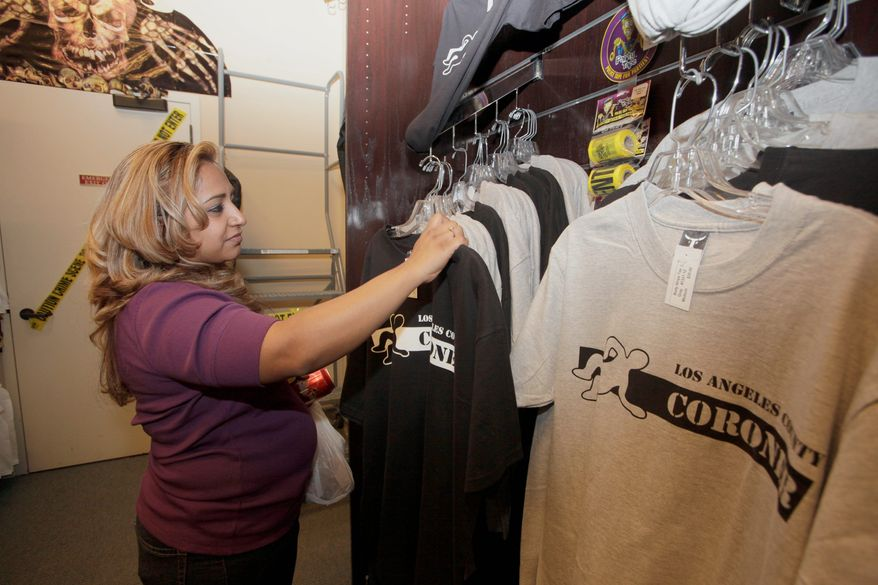 Archie Guerrero browses through merchandise inside the tongue-in-cheek little shop of horrors. Many customers hear about the store through word of mouth or tourist guidebooks. (Associated Press)