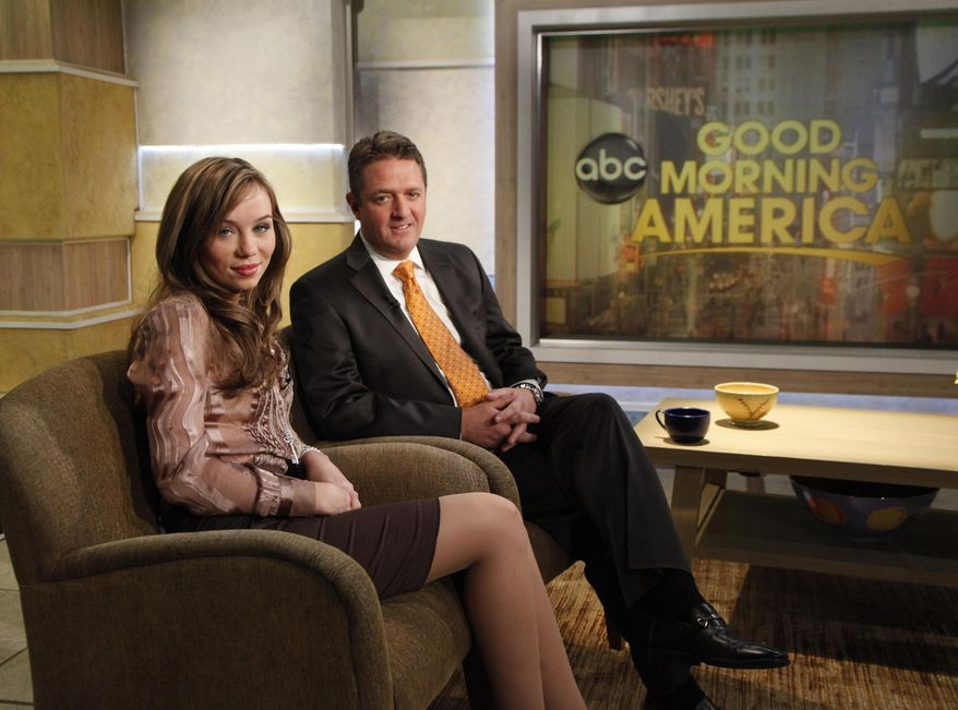 """Capri Anderson, the woman who was found locked in a bathroom of actor Charlie Sheen's hotel room on Oct. 25, 2010, with her attorney, Keith Davidson, during an interview on """"Good Morning America,"""" on Monday, Nov. 22, 2010, in New York. (AP Photo/ABC, Heidi Gutman)"""