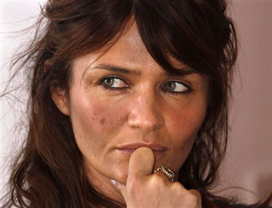 Danish model Helena Christensen poses for photographs as she arrives for a press conference in Katmandu, Nepal, Monday, Nov. 22, 2010. Christensen spent three days in villages in southern Nepal as part of her campaign to highlight the effect of global warming on poor and rural communities. (AP Photo/Binod Joshi)
