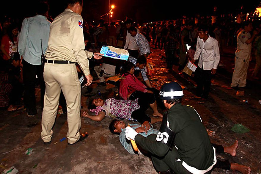 Injured Cambodian visitors are helped after a stampede onto a bridge at an accident site during the last day of celebrations of the water festival in Phnom Penh, Cambodia, Monday, Nov. 22, 2010. Thousands of people celebrating a water festival on a small island in a Cambodian river stampeded Monday evening, killing many people, a hospital official said. Hundreds more were hurt as the crowd panicked and pushed over the bridge to the mainland. (AP Photo/Heng Sinith)