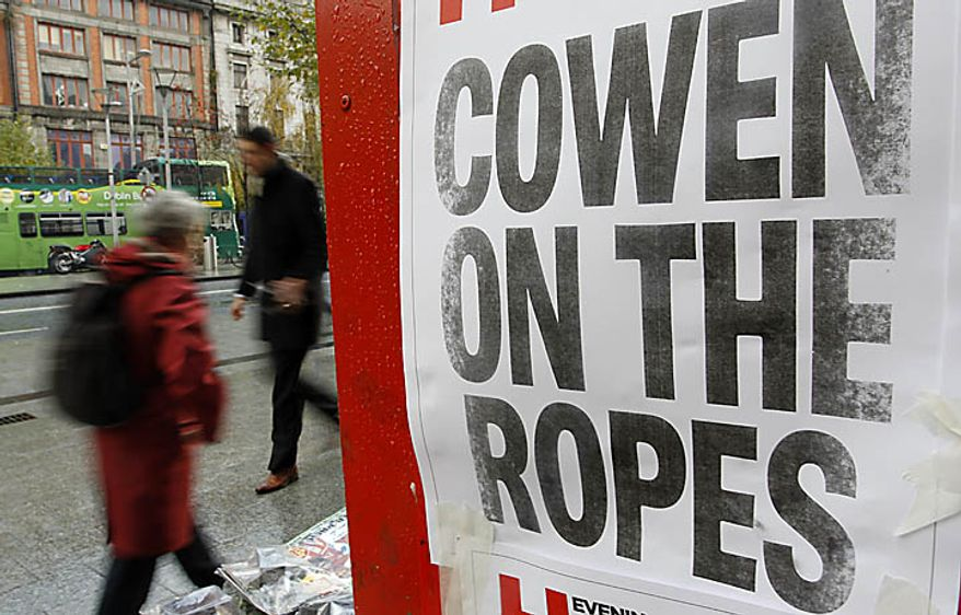 Newspaper headlines in central Dublin, Ireland, Monday, Nov. 22, 2010. Ireland's banks will be pruned down, merged or sold as part of a massive EU-IMF bailout, the government says as a shellshocked nation comes to grips with its failure to protect its financial institutions.  (AP Photo/Peter Morrison)