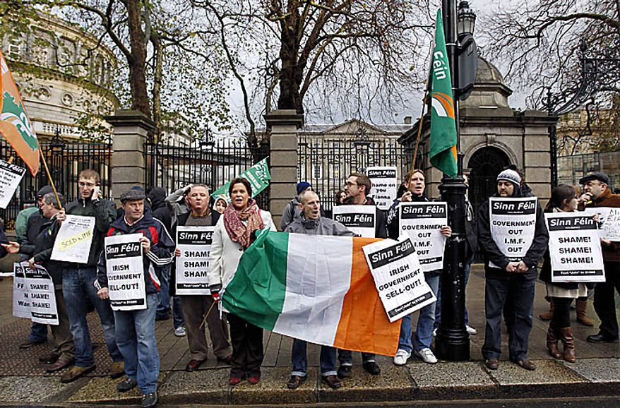Sinn Fein protesters outside Leinster House, which serves as the parliament building, in Dublin, Ireland, Monday, Nov. 22, 2010. Sinn Fein supporters protested the government's handling of the economic crisis and called on the Irish Prime Minister to resign. Ireland's banks will be pruned down, merged or sold as part of a massive EU-IMF bailout, the government says as a shellshocked nation comes to grips with its failure to protect its financial institutions.  (AP Photo/Peter Morrison)