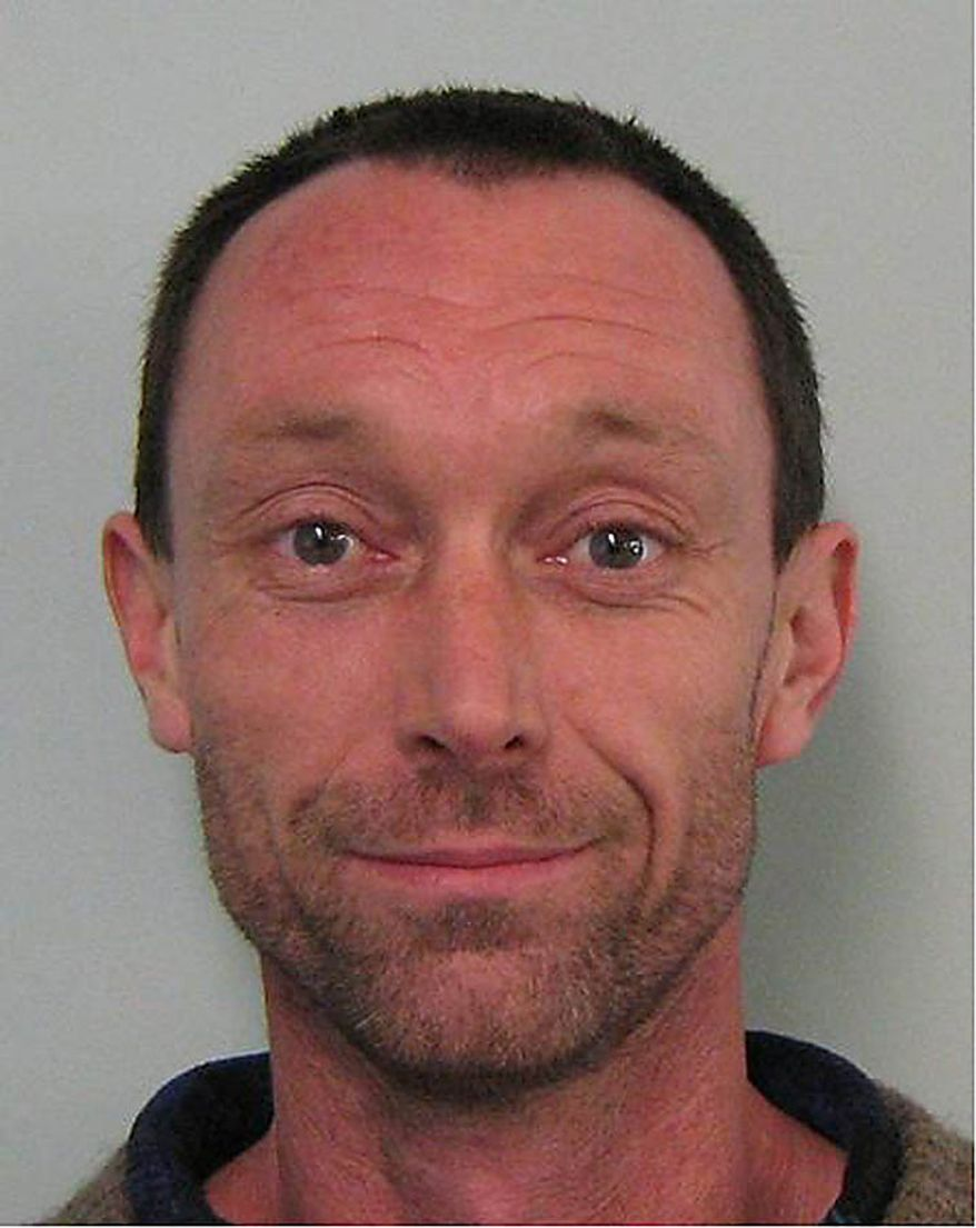 In this undated photo released by New Zealand Police, miner Richard Bennett Holling, 41, from Blackball, New Zealand, poses before the camera. Holling is one of 29 miners believed to be trapped in the Pike River Coal mine near Greymouth, New Zealand, following an explosion at the mine Friday, Nov. 19, 2010. (AP Photo/New Zealand Police)