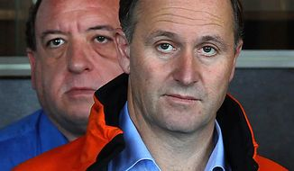 ** FILE ** New Zealand Prime Minister John Key (right) makes comments as Pike River Coal CEO Peter Whittall (left) listens during a press conference in Greymouth, New Zealand, on Monday, Nov. 22, 2010. (AP Photo/New Zealand Herald, Simon Baker)