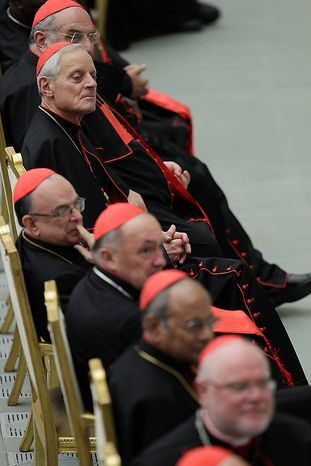 Newly-appointed Cardinal Donald. W. Wuerl, second from top, sits amongst other cardinals as they attend an audience with Pope Benedict XVI for the newly-appointed cardinals and their relatives, in Hall Paul VI at the Vatican, Monday, Nov. 22, 2010. On Saturday the pope created 24 new cardinals. (AP Photo/Andrew Medichini)