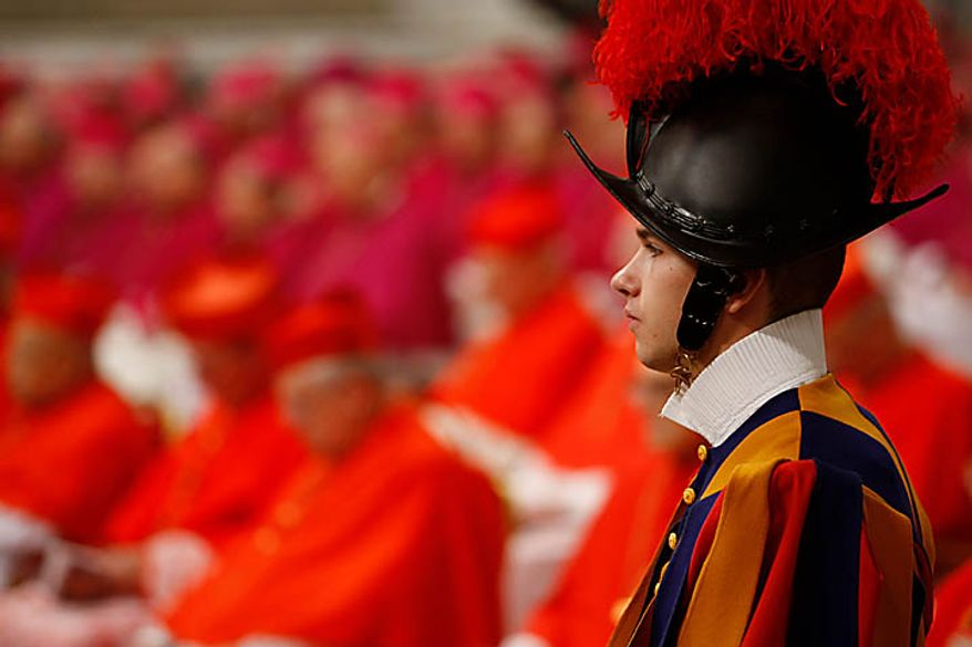 A Swiss guard looks on during a consistory inside St. Peter's Basilica, at the Vatican, Saturday, Nov. 20, 2010. Pope Benedict XVI formally created 24 new cardinals on Saturday amid cheers in St. Peter's Basilica, bringing a mostly Italian group into the elite club that will eventually elect his successor. (AP Photo/Pier Paolo Cito)