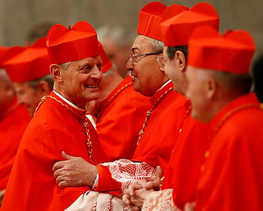 Newly-appointed US Cardinal Donald W. Wuerl, left, is congratulated by other cardinals after being elevated by Pope Benedict XVI during a consistory inside St. Peter's Basilica, at the Vatican, Saturday, Nov. 20, 2010. Benedict XVI formally created 24 new cardinals on Saturday amid cheers in St. Peter's Basilica, bringing a mostly Italian group into the elite club that will eventually elect his successor. (AP Photo/Pier Paolo Cito)