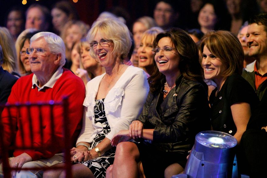 "Former Alaska Gov. Sarah Palin (second from right) sits in the studio audience during the broadcast of ABC's ""Dancing With the Stars"" on Monday in Los Angeles. Mrs. Palin's daughter Bristol is a finalist. (Associated Press)"