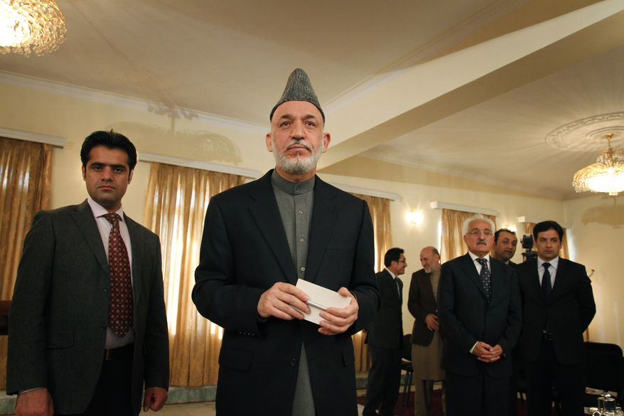 Afghan President Hamid Karzai, during a press conference in Kabul on Tuesday, Nov. 23, 2010, denied he ever met with a senior Taliban leader named Akhtar Mohammad Mansour. (AP Photo/Musadeq Sadeq)