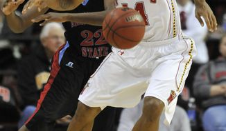 ASSOCIATED PRESS Maryland's Sean Mosely steals the ball from Delaware State's Casey Walker during the first half of an NCAA college basketball game, Tuesday, Nov. 23, 2010, in College Park, Md.