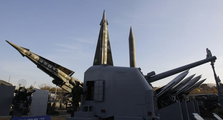 A South Korean soldier walks by displays of mock North Korea's Scud-B missile, back right, and other South Korean missiles at Korea War Memorial Museum in Seoul, South Korea, on Tuesday, Nov. 23, 2010. North Korea shot dozens of rounds of artillery onto a populated South Korean island near their disputed western border Tuesday, military officials said, setting buildings on fire and prompting South Korea to return fire and scramble fighter jets. (AP Photo/Lee Jin-man)