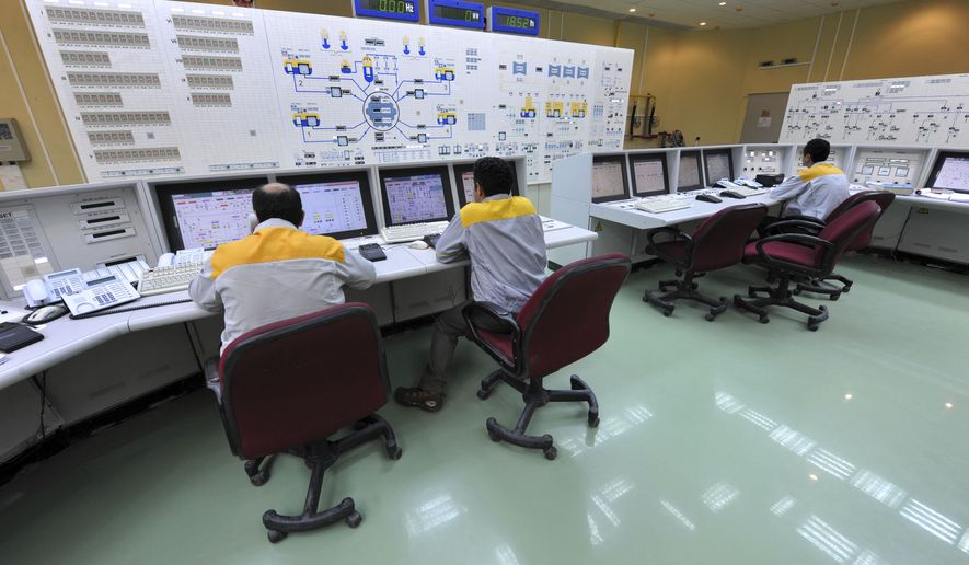 ** FILE ** Iranian technicians work at the Bushehr nuclear power plant, outside the southern city of Bushehr, Iran, on Monday, Aug. 23, 2010. Iran's nuclear chief said on Tuesday Nov. 23, 2010, that a malicious computer worm known as Stuxnet had not harmed the country's atomic program and accused the West of trying to sabotage it. Iran earlier confirmed that Stuxnet had infected several personal laptops belonging to employees at the Bushehr  plant but that plant systems were not affected. (AP Photo/International Iran Photo Agency, Ebrahim Norouzi)