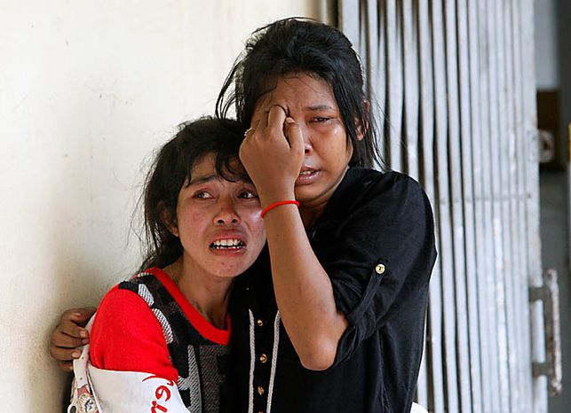 Relatives cry at Preah Kossamak Hospital where the bodies of stampede victims are laid in Phnom Penh, Cambodia, Tuesday, Nov. 23, 2010. Thousands of people stampeded during a festival in the Cambodian capital, leaving over three hundred dead and scores injured in what Prime Minister Hun Sen called the country's biggest tragedy since the 1970s reign of terror by the Khmer Rouge. (AP Photo/Sakchai Lalit)