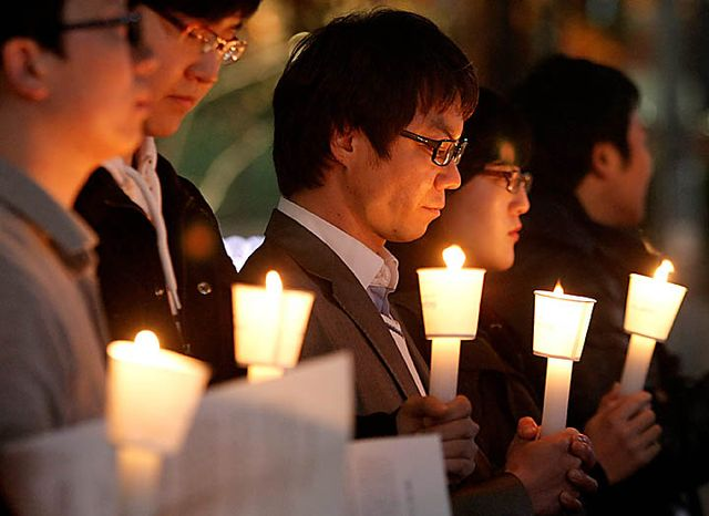 South Koreans take moment of silence for South Korean marines killed in a North Korean bombardment during a rally against North Korea's attack onto South Korean island, in Seoul, South Korea, Tuesday, Nov. 23, 2010. North Korea shot dozens of rounds of artillery onto a populated South Korean island near their disputed western border Tuesday, military officials said, setting buildings on fire and prompting South Korea to return fire and scramble fighter jets. (AP Photo/Ahn Young-joon)