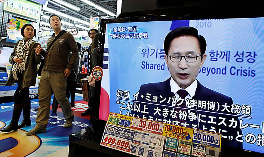 A TV shows image of South Korean President Lee Myung-bak in a news program at an electronics store in downtown Tokyo, Japan, Tuesday, Nov. 23, 2010. North Korea fired artillery barrages onto a South Korean island near their disputed border Tuesday, setting buildings alight and prompting South Korea to return fire and scramble fighter jets. (AP Photo/Shizuo Kambayashi)