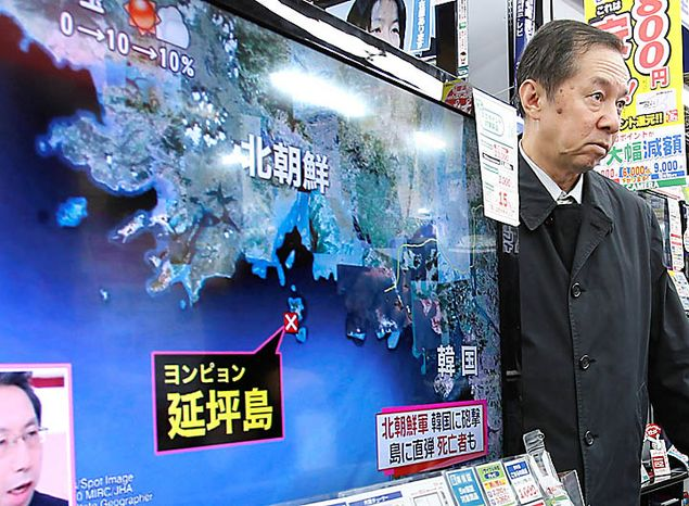 A TV screen shows a map of South Korea's Yeonpyeong island, center, in a news program at an electronics store in downtown Tokyo, Japan, Tuesday, Nov. 23, 2010.  North Korea fired artillery barrages onto a South Korean island near their disputed border Tuesday, setting buildings alight and prompting South Korea to return fire and scramble fighter jets. (AP Photo/Shizuo Kambayashi)