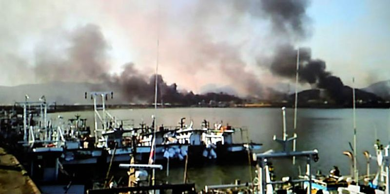 Smoke billow from Yeonpyeong island near the border against North Korea, in South Korea, Tuesday, Nov. 23, 2010. North Korea shot dozens of rounds of artillery onto the populated South Korean island near their disputed western border Tuesday, military officials said, setting buildings on fire and prompting South Korea to return fire and scramble fighter jets. (AP Photo/Yonhap)