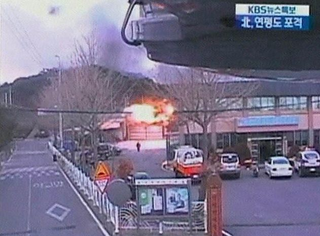 In this image take from TV footage, flames lit up just after artillery hit an area of South Korea's Yeonpyeong island near the border against North Korea, Tuesday, Nov. 23, 2010. North Korea shot dozens of rounds of artillery onto the populated South Korean island near their disputed western border Tuesday, military officials said, setting buildings on fire and prompting South Korea to return fire and scramble fighter jets. (AP Photo/KBS via APTN)