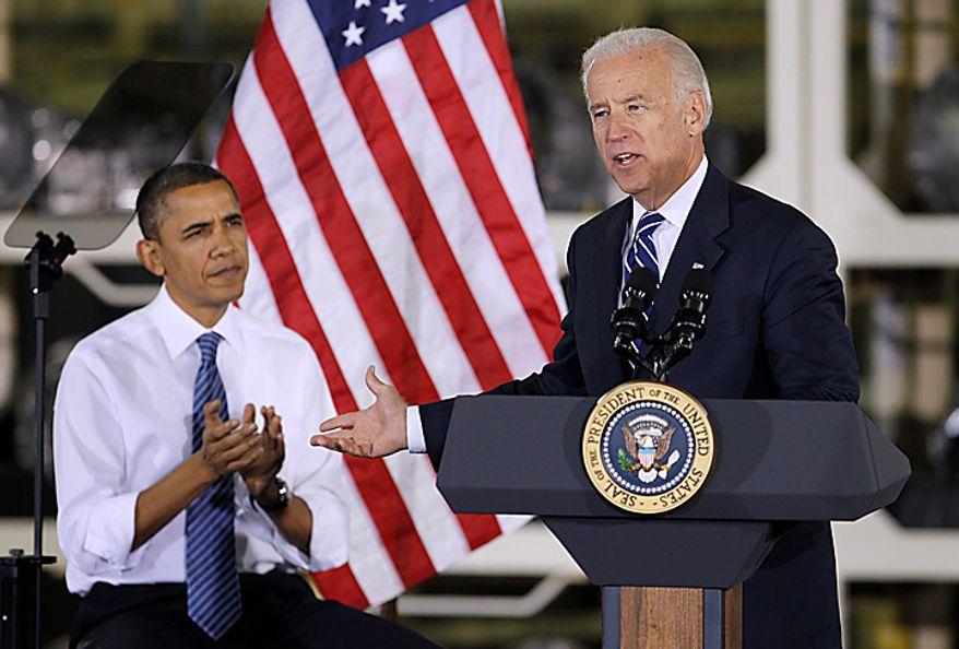 Vice President Joe Biden speaks while President Barack Obama reacts at the Chrysler Indiana Transmission Plant II in Kokomo, Ind., Tuesday, Nov. 23, 2010. (AP Photo/Darron Cummings)
