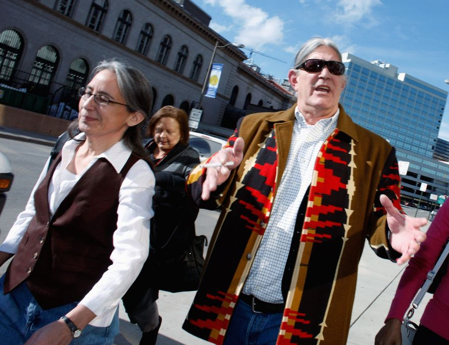 Ex-University of Colorado professor Ward Churchill and his wife, Natsu Saito (left), leave court in 2009 after a jury said he was wrongfully fired. The judge vacated the ruling and denied his reinstatement request. Mr. Churchill lost his appeal Wednesday. (Associated Press)