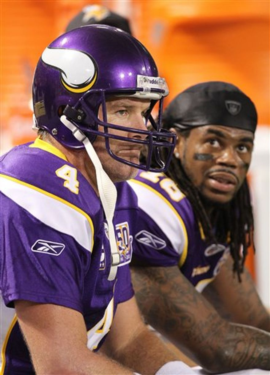 Minnesota Vikings quarterback Brett Favre (4) and Minnesota Vikings wide receiver Sidney Rice (18) watch from the bench in the fourth quarter of an NFL football game against the Green Bay Packers in Minneapolis Sunday, Nov. 21, 2010.(AP Photo/Andy King)
