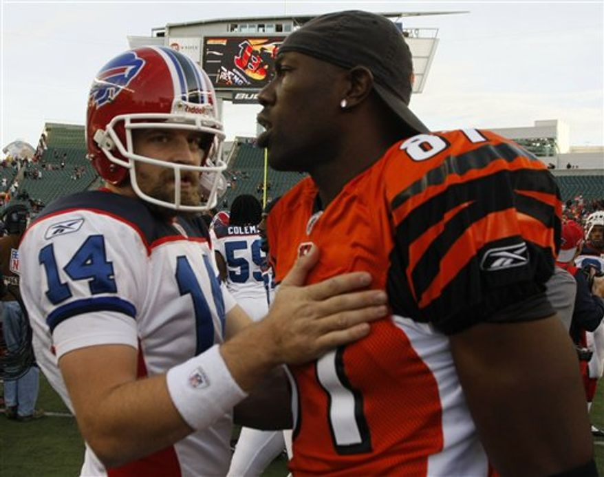 NOT Buffalo Bills quarterback Ryan Fitzpatrick (14) talks with Cincinnati Bengals' Terrell Owens (81) after the Bills defeated the Bengals 49-31 in an NFL football game, Sunday, Nov. 21, 2010, in Cincinnati. (AP Photo/David Kohl)