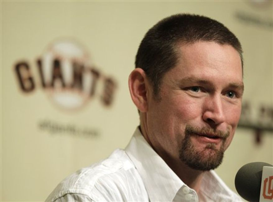 San Francisco Giants infielder Aubrey Huff shakes hands with reporters after talking about his new contract, in San Francisco on Tuesday, Nov. 23, 2010. The Giants announced Tuesday they have re-signed Huff to a two-year contract with a club option for the 2013 season. (AP Photo/Eric Risberg)