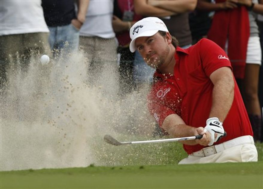 Graeme McDowell of of Northern Ireland hits a putt at the 17th hole in the third round of the Hong Kong Open golf tournament on Saturday, Nov. 20, 2010 in Hong Kong.  (AP Photo/Kin Cheung)