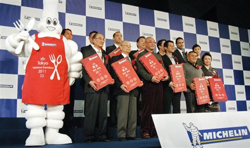 A copy of the latest Japanese edition of the Michelin Guide featuring selected restaurants in Japanese cities of Tokyo, Yokohama and Kamakura is on display during a news conference in Yokohama, Japan, Wednesday, Nov. 24, 2010. Japan's capital retained the top spot in the world of gastronomy , earning more three-star restaurants than Paris in the guide for the second year in a row. (AP Photo/Kyodo News, Nozomi Iwakiri) JAPAN OUT, MANDATORY CREDIT, FOR COMMERCIAL USE ONLY IN NORTH AMERICA