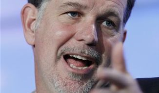 FILE - In this file photo taken Nov. 17, 2010, Netflix CEO Reed Hastings speaks at the Web 2.0 Summit in San Francisco. Netflix is betting that DVDs will soon go the way of the VHS tape. A new, cheaper plan offers movies exclusively by streaming and bypasses the discs by mail and their familiar red envelopes. (AP Photo/Paul Sakuma, file)