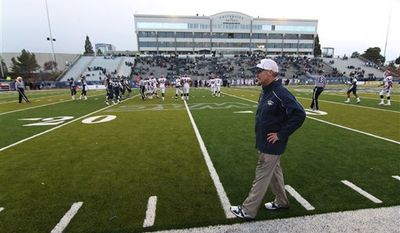 Nevada head coach Chris Ault, foreground, walks the sidelines in the final minutes of an NCAA college football game against New Mexico State on Saturday, Nov. 20, 2010, in Reno, Nev. (AP Photo/Cathleen Allison)