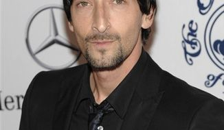 "FILE - In this Oct. 23, 2010 file photo, actor Adrien Brody arrives at the 32nd Annual Carousel of Hope Ball in Beverly Hills, Calif. A federal judge in Los Angeles has blocked the makers of a thriller film starring Adrien Brody from using the Oscar-winning actor's likeness until he is fully paid for his role.  U.S. District Judge Dale S. Fischer issued a ruling Monday, Nov. 22, 2010, blocking the makers of ""Giallo"" from continuing to distribute, market or sell the film in the United States. (AP Photo/Dan Steinberg, file)"